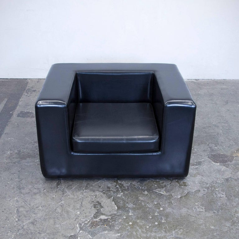 Zanotta throw away club chair set black faux leather one for Where to throw away furniture