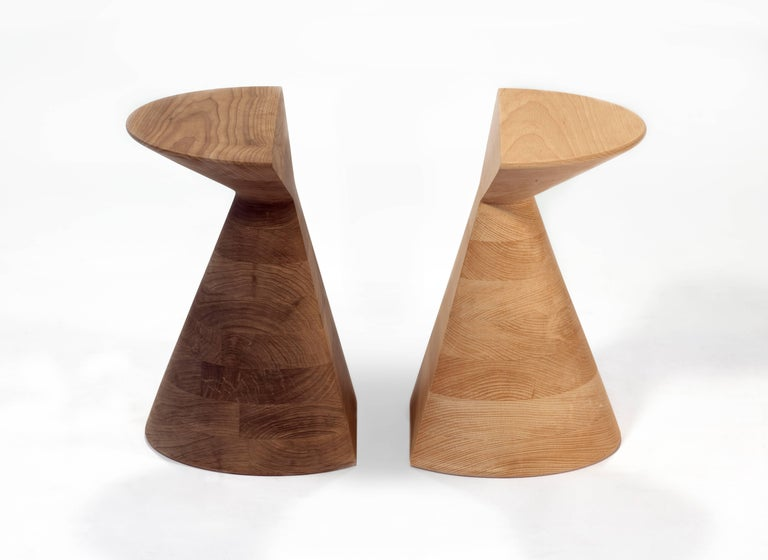 This stool is made of walnut hardwood.  Our small size.  Measures: 34 x 34 x 38 H cm.