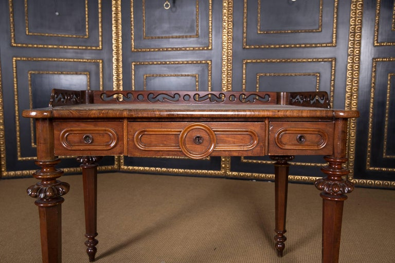 Mahogany on solid conifers. High knee pocket on the front with finely worked drawers, slightly protruding top plate, on high and fine-edged ball-shaped columns. Finally perforated gallery border.  A good historical condition with a beautiful warm