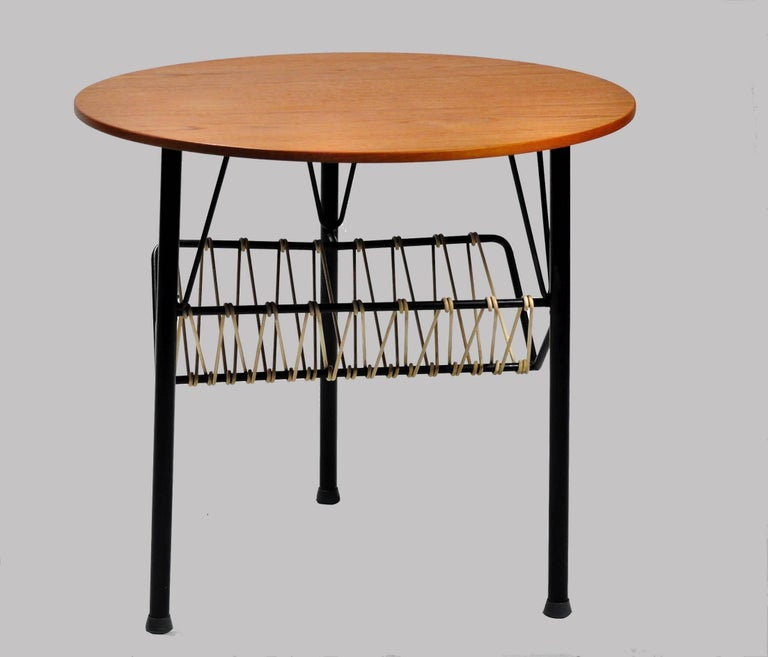 Side table in teak and black metal from the 1950s.  The table is in very good condition