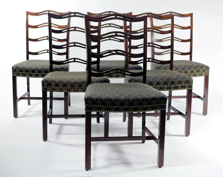 Handcrafted mahogany dining chairs by Danish master cabinetmaker Georg Kofoed in the 1930s with original beautifull fabric upholstery and labels from Georg Kofoeds workshop.  The set of dining chairs features very well crafted elegant frames and