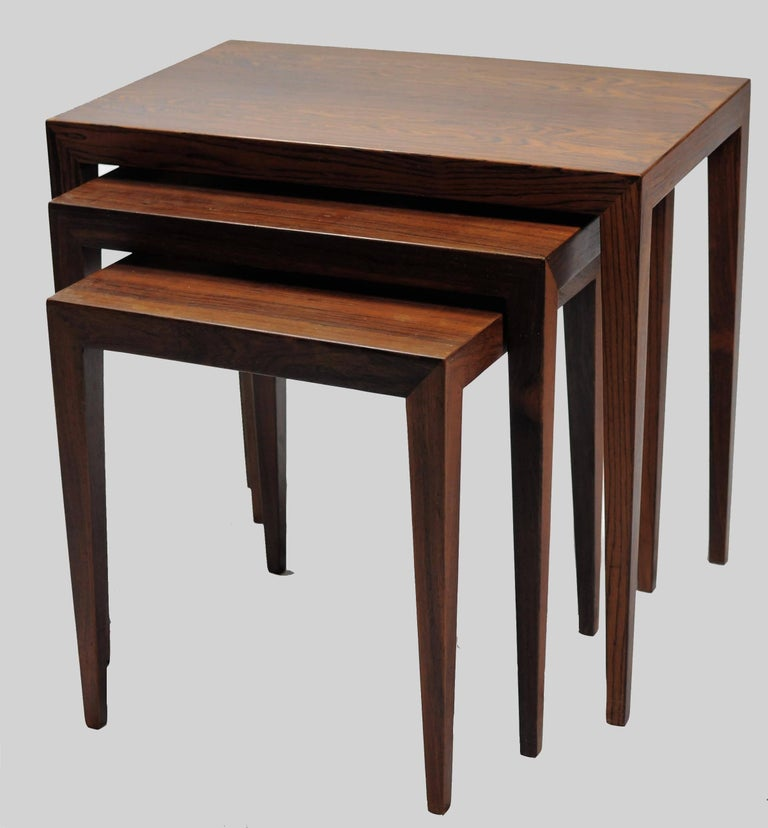 Set of three nesting tables in rosewood designed by Severin Hansen Jr for Haslev Møbelfabrik.  Danish furniture designer Severin Hansen Jr. is best remembered for his table and desk designs in the classic, Danish midcentury modern style. In the