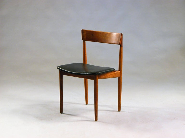 Set of four model 39 dining chairs in teak and black leather designed by Henry Rosengren Hansen for Brande Møbelindustri, Denmark, in the 1960s.   The chairs are made of solid teak with leather seats. The chairs are well crafted with the special