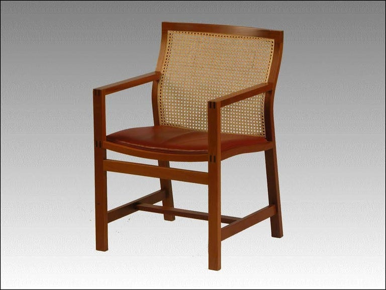 This pair of chairs, model 7512, was designed for Fredericia Furniture A/S in 1981 as part of the Classic Kings Furniture series, which has been designed since 1969, named such because the Danish King Frederik IX received some of the models as gift