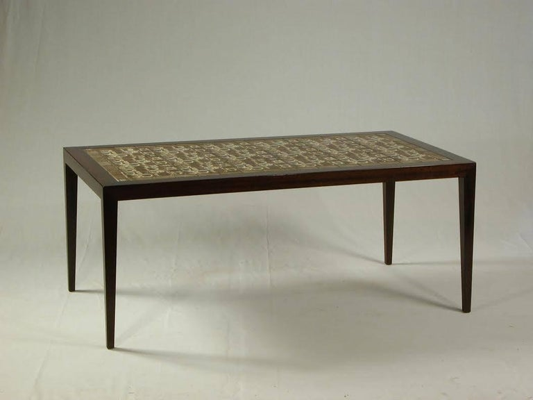 Rosewood Coffee table designed by Severin Hansen for Haslev Møbelsnedkeri with Niels Thorsson tiles made and branded by Royal Copenhagen, Denmark.  The Coffee table has been restored and has only small signs of age and use.  See Royal Copenhagen