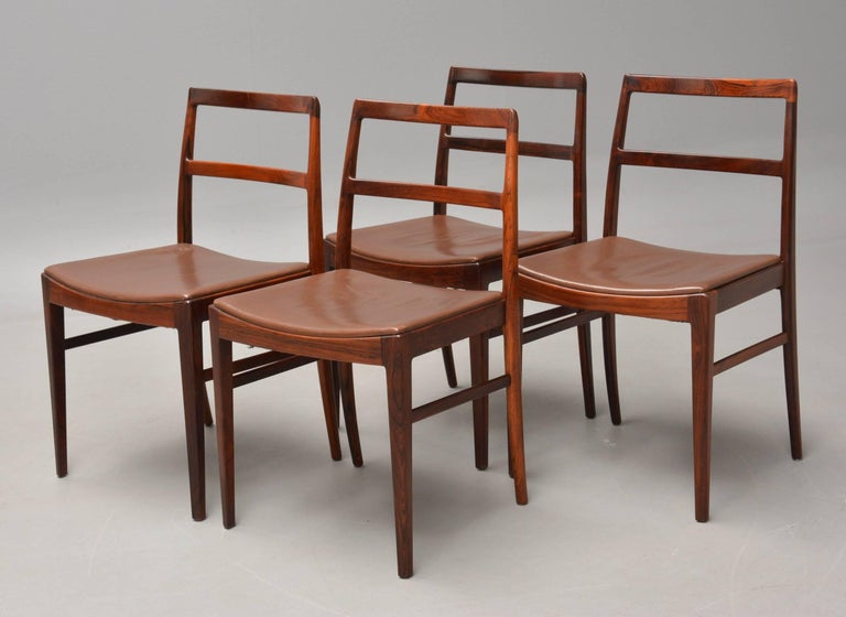 Set of four model 430 dining chairs designed by Arne Vodder for Sibast Møbelfabrik.   The chairs are made from rosewood and are, with their elegant design and joints that are hardly visible but float into each other, evidence of the superb design