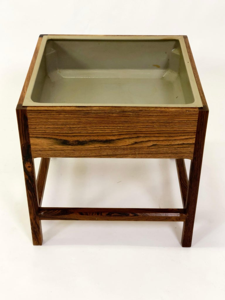 1960s Kai Kristiansen rosewood planter by Aksel Kjaersgaard.  The planter has been overlooked by our cabinetmaker and is in very good condition.