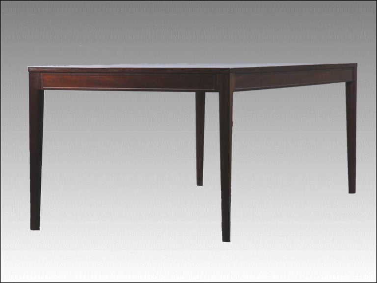 Finn Juhl designed a series of furniture´from 1961 called the Diplomat series with chairs, desks, tables, cabinets and other furniture that was made in Bangkok teak, rosewood and mahogany.  The conference / dining table has a simple but very elegant