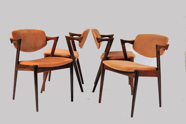 Model 42 teak dining chairs with adjustable backrest with different types of upholstery by Kai Kristiansen for Schous Møbelfabrik.  The chairs have Kai Kristiansens typical light and elegant design that make them fit in easily where you want them in
