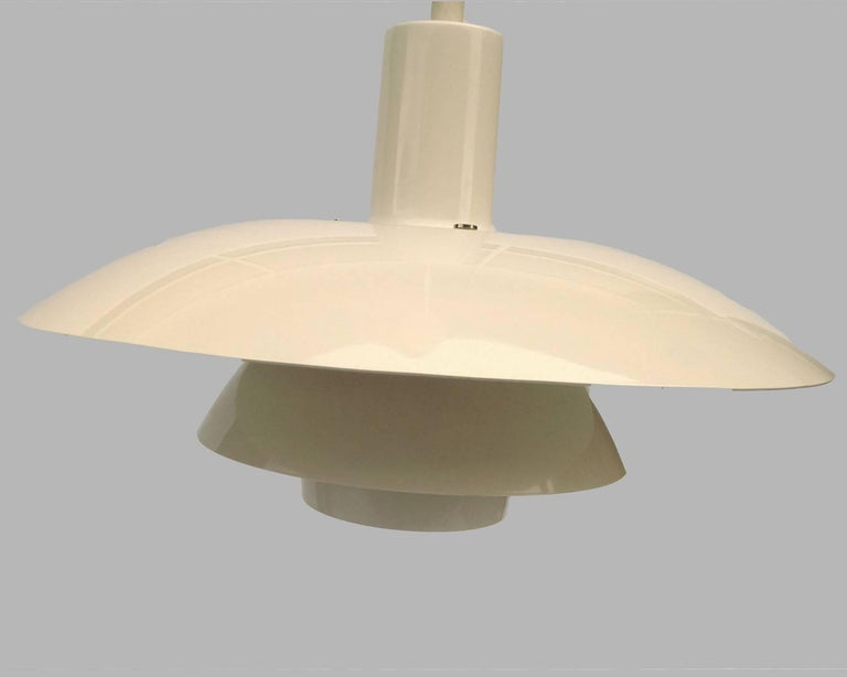 This pendant lamp, model 117077 (PH 4 1/2-4 Metal), was designed by Poul Henningsen for Louis Poulsen. The model is no longer in production in this size.  The pendant lamp is in a very good vintage condition.