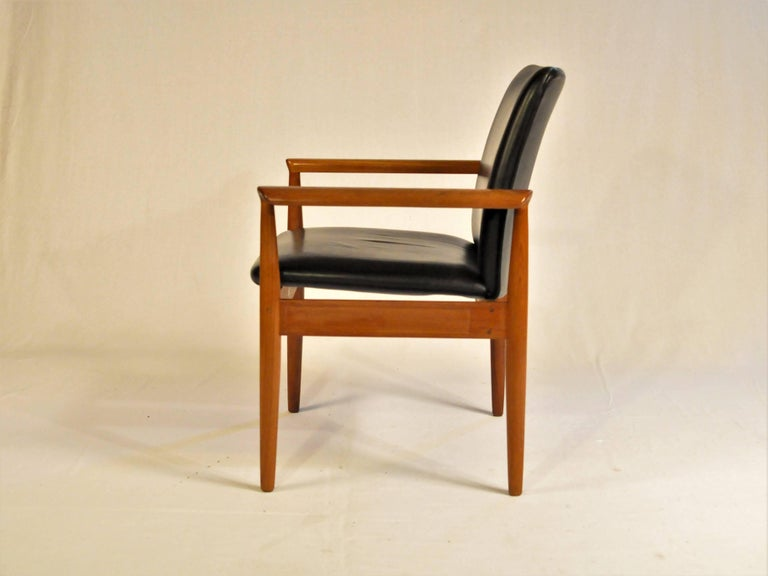 Set of six Finn Juhl armchairs in Bangkok teak and black leather designed in 1963 and made by France and Son / Cado in the 1960s  The armchairs have a solid stabile frame in teak and seats in black leather with deep foam that make them very