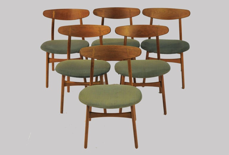 A set of six Hans Wegner dining chairs designed in 1952 for Carl Hansen & Søn. The simple yet sophisticated CH30 design has become an iconic Classic among Wegners chairs. The exposed joint between the teak backrest and the oak rear post is a feature