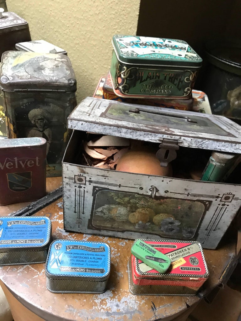 """Wonderful and crazy such a collection of """"tins"""" circa 1900 Tins for food, wax, bullets, coffee, tea, candy, flower etc ....... and a tin duck beautiful  with respect off age and little defaults of time."""