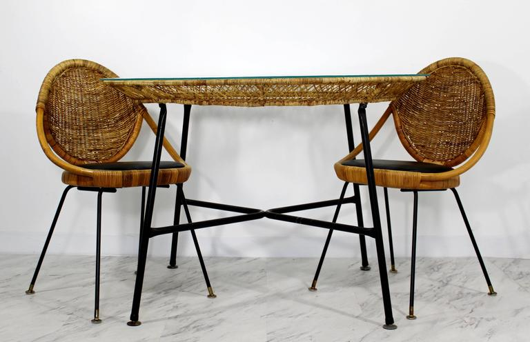 """For your consideration is a gorgeous patio set, including a table and two chairs, made of bamboo, rattan and wrought iron by Danny Ho Fong for Tropi-cal. In excellent condition. The dimensions of the table are 43"""" D x 30"""" H and the chairs"""