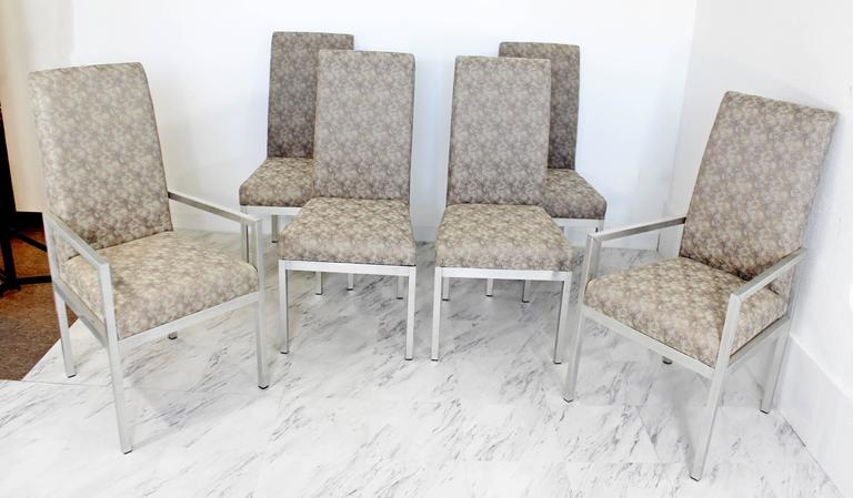"For your consideration is a stunning set of six aluminum base dining chairs. Two armchairs and four side chairs. Attributed to Milo Baughman for DIA. In excellent condition. The dimensions are 20""/21.5"" W x 22"" D x 41.5"" H x"