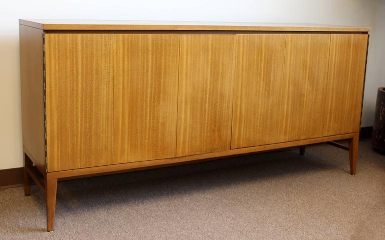 For Your Consideration Is An Incredibly Sleek, Bleached Mahogany Credenza,  With Folding Doors And