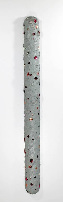 For your consideration is an untitled, hanging wall sculpture, made of grey oil with glass jewels on wood, by John Torreano in 1975. In excellent condition. The dimensions are 4