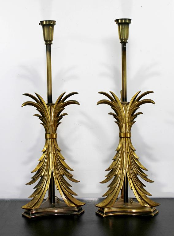 For your consideration is a wonderful pair of Hollywood Regency, solid brass table lamps by Chapman, circa the 1980s. In excellent condition. The dimensions are 10