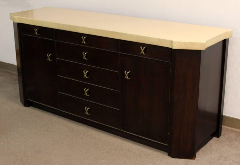 For your consideration is a gorgeous credenza, with a cork top, seven drawers and two shelves, by Paul Frankl for Johnson Furniture, circa the 1950s. In excellent condition. Hutch is also available in a separate posting. The dimensions are 72""