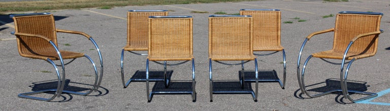 For your consideration is a gorgeous set of six dining chairs, two arm and four side, made of cane and chrome, by Mies van der Rohe MR10 for Stendig, Denmark, circa the 1970s. Just back from being professionally redone. In excellent condition. The