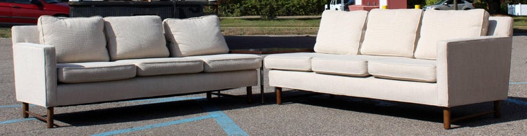 "For your consideration is a fantastic, two-piece, sectional sofa, on a unique, wooden base, by Dunbar. In original nubby oatmeal wool blend fabric. In excellent condition. The dimensions of each piece are 70"" W x 31"" D x 27"" B.H x 17"" S.H."