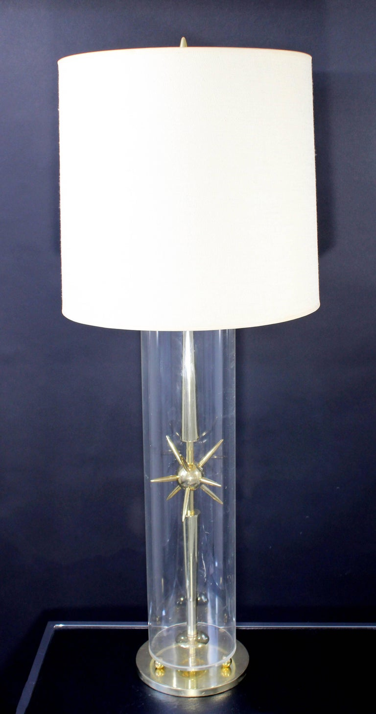 For your consideration is a mod and elegant, Sputnik table lamp, made of brass and glass, from Mutual Sunset Lamp Co. Includes original shade and finial. In excellent condition. The dimensions of the shade are 15