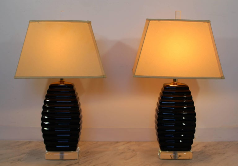 For your consideration is a gorgeous pair of Lucite table lamps, in the beehive style, with their original Lucite finials, by Bauer. In excellent condition. The dimensions of the lamps are 8.5