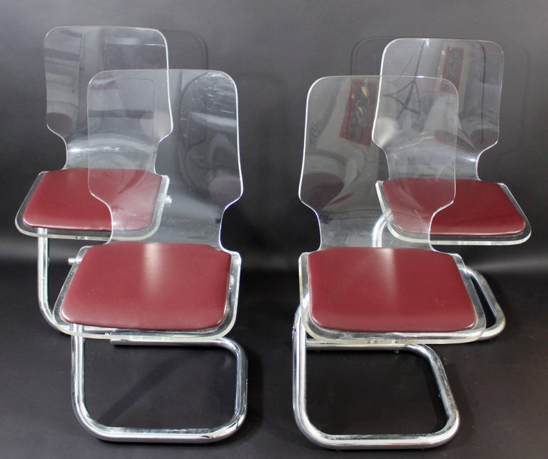 """For your consideration is a fantastic set of four, Lucite and tubular chrome, side dining chairs, by Hill Manufacturing Corporation, circa the 1970s. Designed by Luigi Bardini Italy. In excellent condition. The dimensions are 16"""" W x 18"""" D"""