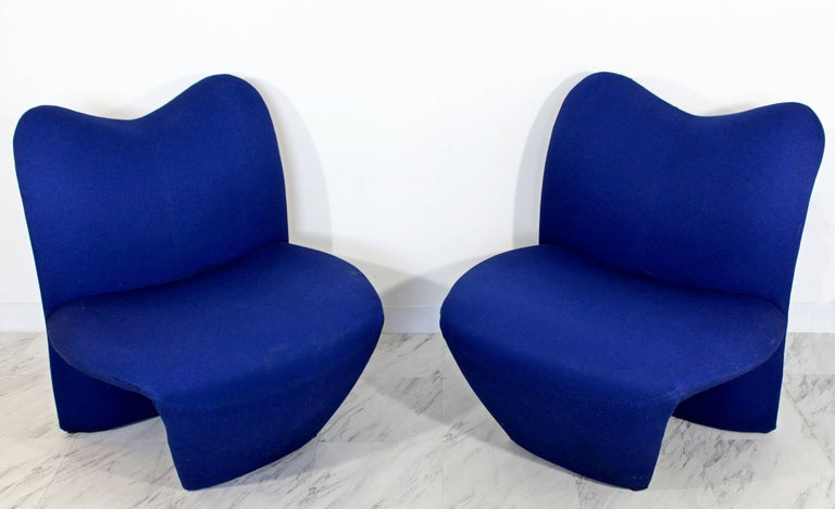 For your consideration is a fabulous pair of Sculpted, side lounge chairs. In good vintage condition, with condition issues shown in pictures 7 & 8. Can be used as is with a small throw over the chair to cover the tear or to be reupholstered. The