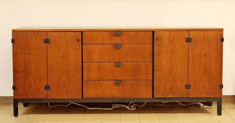 For your consideration is a gorgeous, walnut credenza, with four drawers and two storage spaces, by Kipp Stewart for Directional, circa the 1950s. In excellent condition. The dimensions are 72