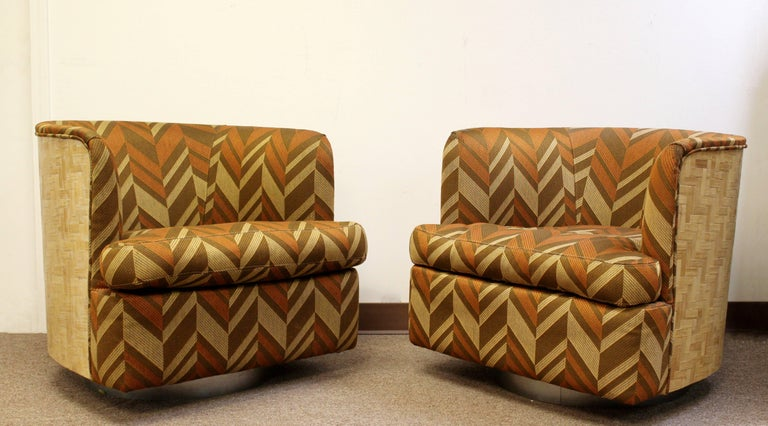 For your consideration is a fantastically rare pair of barrel swivel chairs, with parquet wood sides and chrome bases, by Milo Baughman for Thayer Coggin, circa 1960s. In good condition, with some flaws on two of the arms, that are shown in the