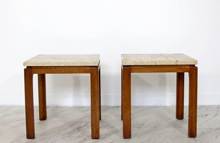 For your consideration is an incredible pair of travertine topped side or end tables, on square walnut bases, by Harvey Probber, circa 1960s. In very good condition. The dimensions of each are 16