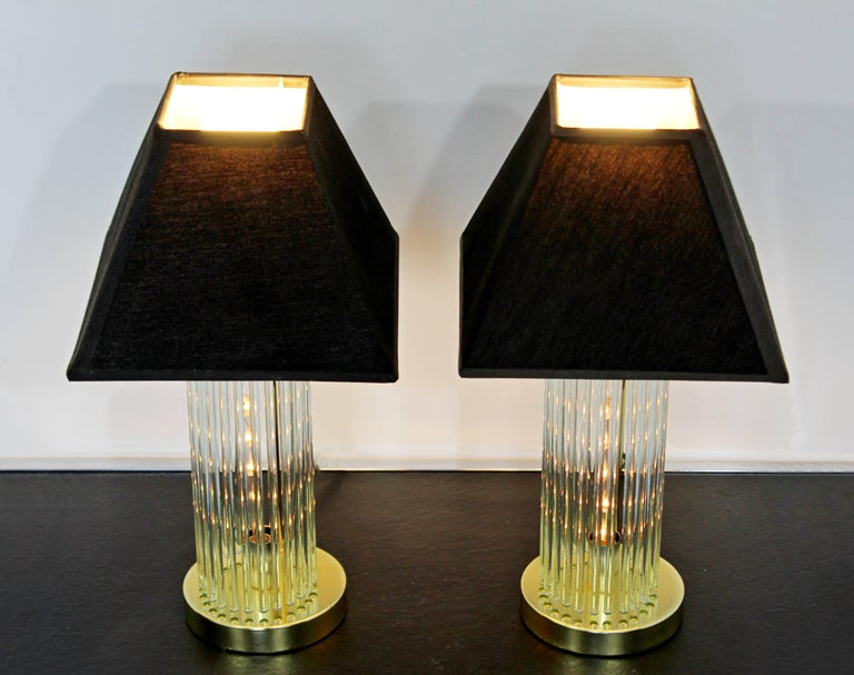 For your consideration is a small pair of glass rod and brass table lamps, by Gaetano Sciolari for Lightolier, circa 1970s. In excellent condition. The dimensions of each, with their shades, are 9