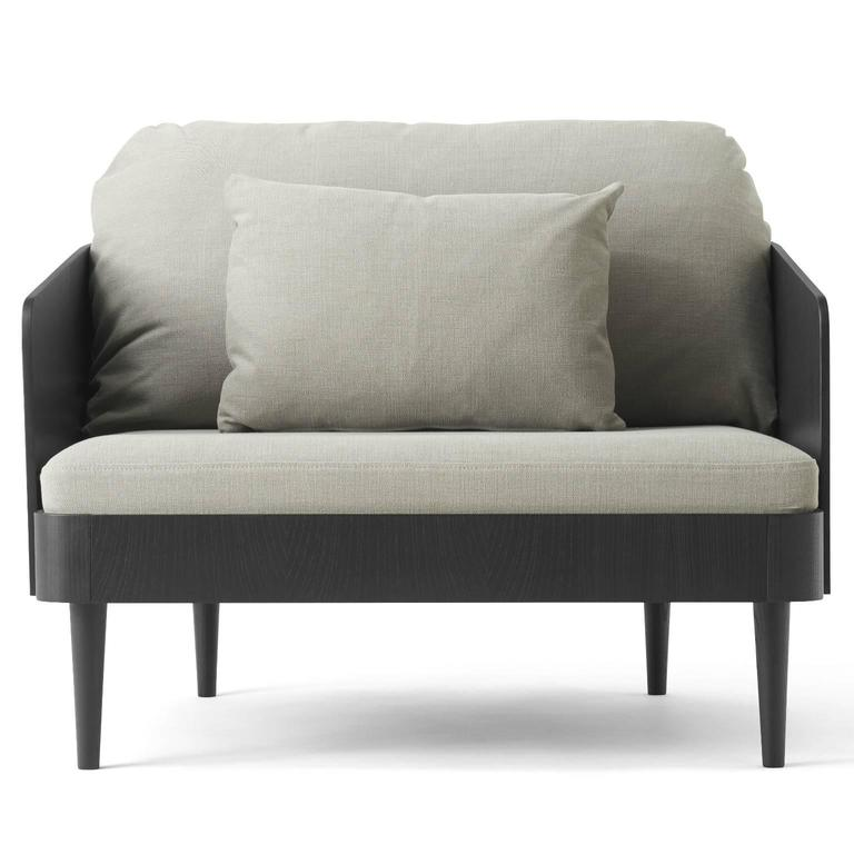 The Septembre series solves an age-old conundrum of sofa design: while fully-upholstered sofas are comfortable, they often look boxy and inelegant. More structured sofas are aesthetically pleasing yet are seldom made for relaxation. The Septembre