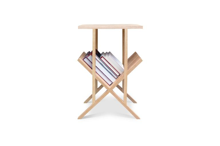 Named for the lap joints that make up its structure, the Lap Table is a versatile piece that can easily function as a side table, end table, nightstand, or entry table with a place for reading materials or mail. When viewed straight on, the form,