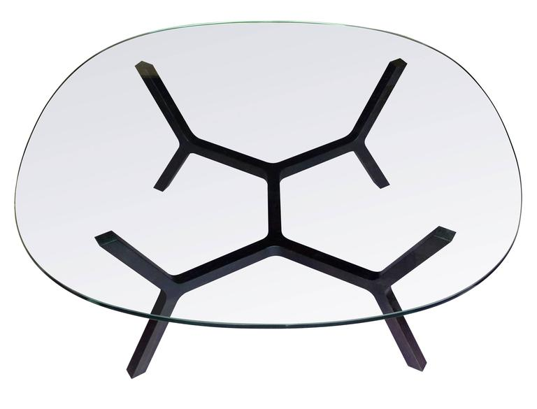 The stick table evolved out of experiments with traditional Japanese joinery. A unique locking tenon joint allows three pieces of wood to be joined at 120-degree angles. The joint is repeated throughout the table resulting in a symmetrical branching