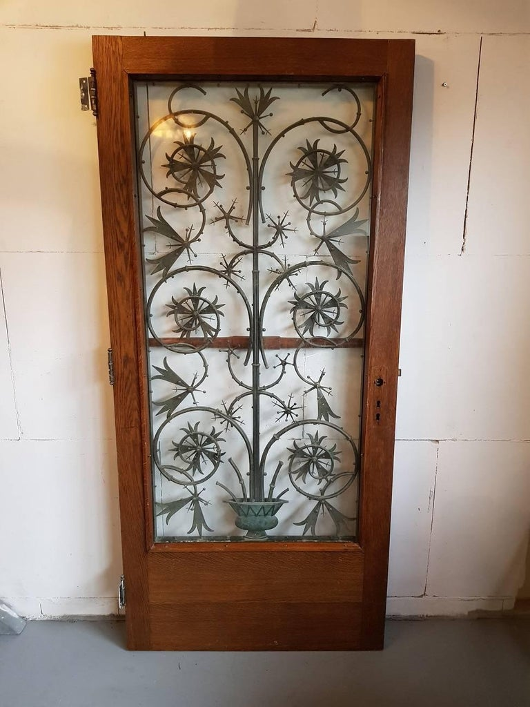Handmade bronze Art Nouveau door grille mounted in a solid oak door from about 1910. The grille can be sold with out the door.  The measurements including the door are,  Depth 4,5 cm/ 1.7 inch.  The bronze grille alone is Depth 3,5 cm/ 1.3
