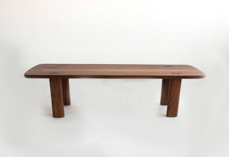 The Lakai bench is built by hand in our Brooklyn studio using premium hardwoods. Simple and sturdy, the bench highlights its exaggerated through joints and a minimal Silhouette. Sized for a standard dining bench, it also well suited as a coffee or