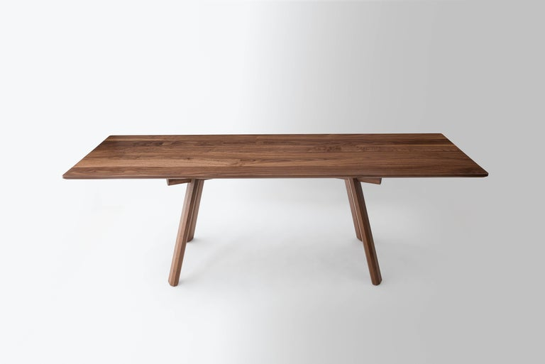The Ripley dining table is built by hand on our Brooklyn Studio using premium hardwoods. The base is constructed with traditional joinery. The faceted legs help to showcase the exaggerated lap joints that give the table its robust feel and