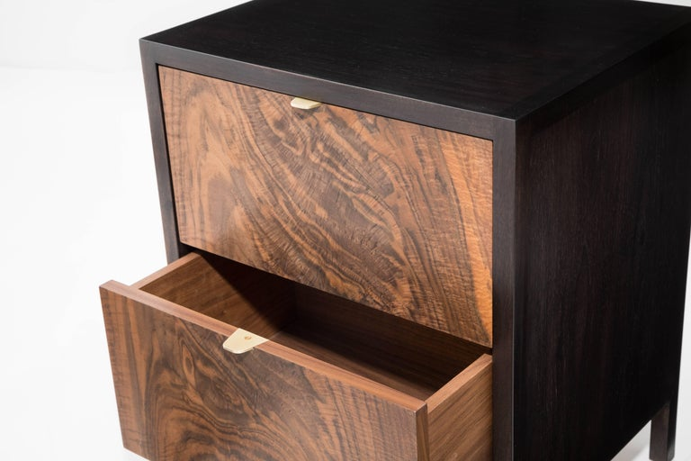 The Laska Nightstand is built in our Brooklyn studio using premium hardwoods and thoughtfully selected wood veneers. This piece features custom veneered panels framed flush with solid hardwood edges and legs. The two drawers showcase crotch-cut