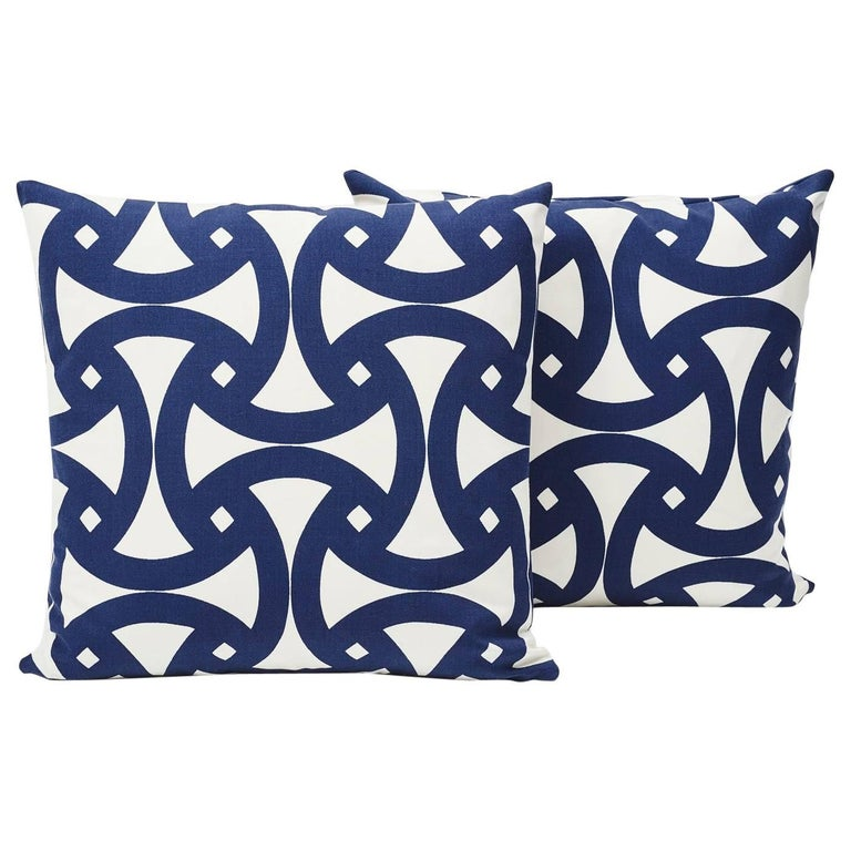 This marine blue geometric print, filled with interlocking curves, has a bold flair sure to heighten any setting! Made from 100% acrylic duck, this Schumacher Santorini print pillow is great for both indoor and outdoor use.  Since Schumacher was
