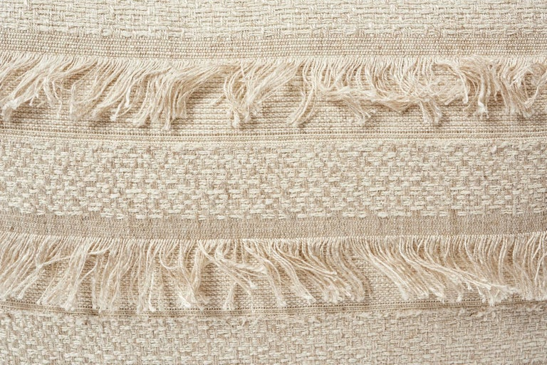 A horizontal fringed stripe, Schumacher's Acadia derives from a textile in our archives. Beautifully woven with silky mélange yarn, it has an artisanal look and multi-textural appeal. Featured as a decorative accent, this is sure to luxuriously
