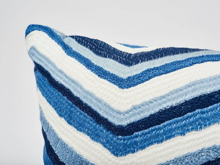 Schumacher's Shasta Embroidery is notable for its rich, textured all-over embroidery. Each chevron stripe is made of a different stitch, giving this fabric a unique, handcrafted look. Featured in its dynamic blue color way, this decorative accent is