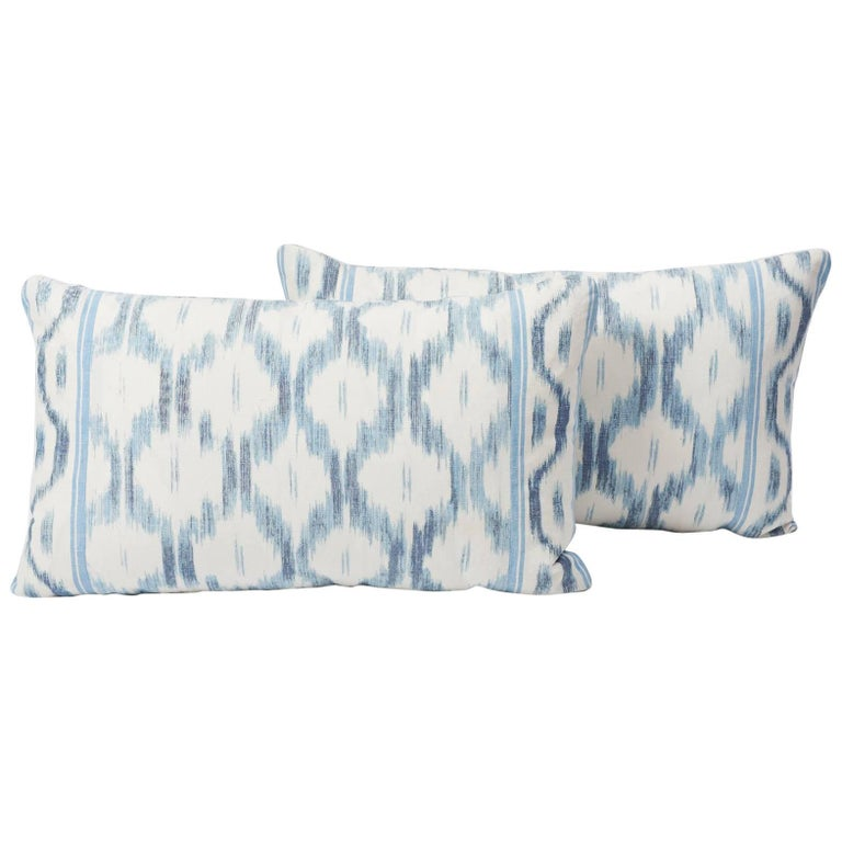This artisanal crafted Schumacher pattern, in collaboration with Mark D. Sikes, puts a fresh spin on an archival ikat. Santa Monica Ikat's geometric design adds a modern and playful twist on this lumbar pillow. In this indigo color way, this