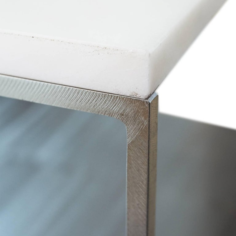 Glamorous yet Minimalist end table sourced from Belgium. It features solid white marble set atop a stunning bright steel frame. A statement piece to elevate any interior or setting!  Dimensions: 23.75