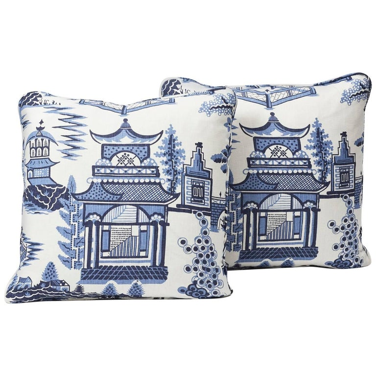 Based on an archival print, Nanjing is a modern take on Classic chinoiserie motifs, with stylized trees, pagodas and fretwork fences. Featured as a decorative accent, this Schumacher Classic pattern is sure to elevate and modernize any interior or