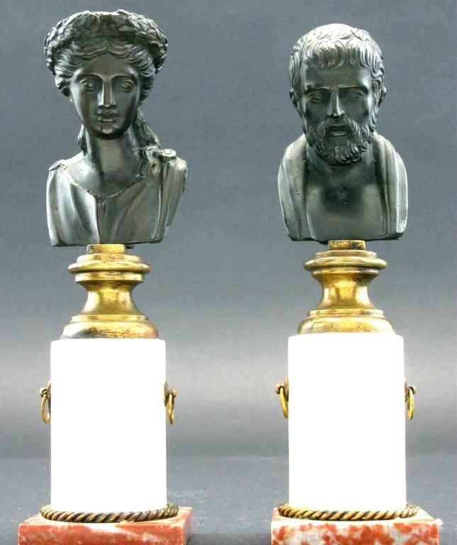 Both raised on white alabaster columns with gilt metal rings, atop squared rouge royal marble bases decorated with gilt metal wrythen hoops. Unmarked but likely produced at the Gladenbeck und Sohn Foundry, Germany. (International clients are tax