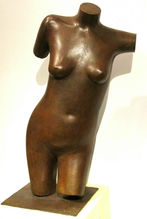A finely proportioned 3/4 length nude bronze torso, exhibiting a fine reddish / brown patina overall, supported on it's detachable base. Signed on the base with the artist's initials.  George Foster is a member of the Sculptors Society of Canada
