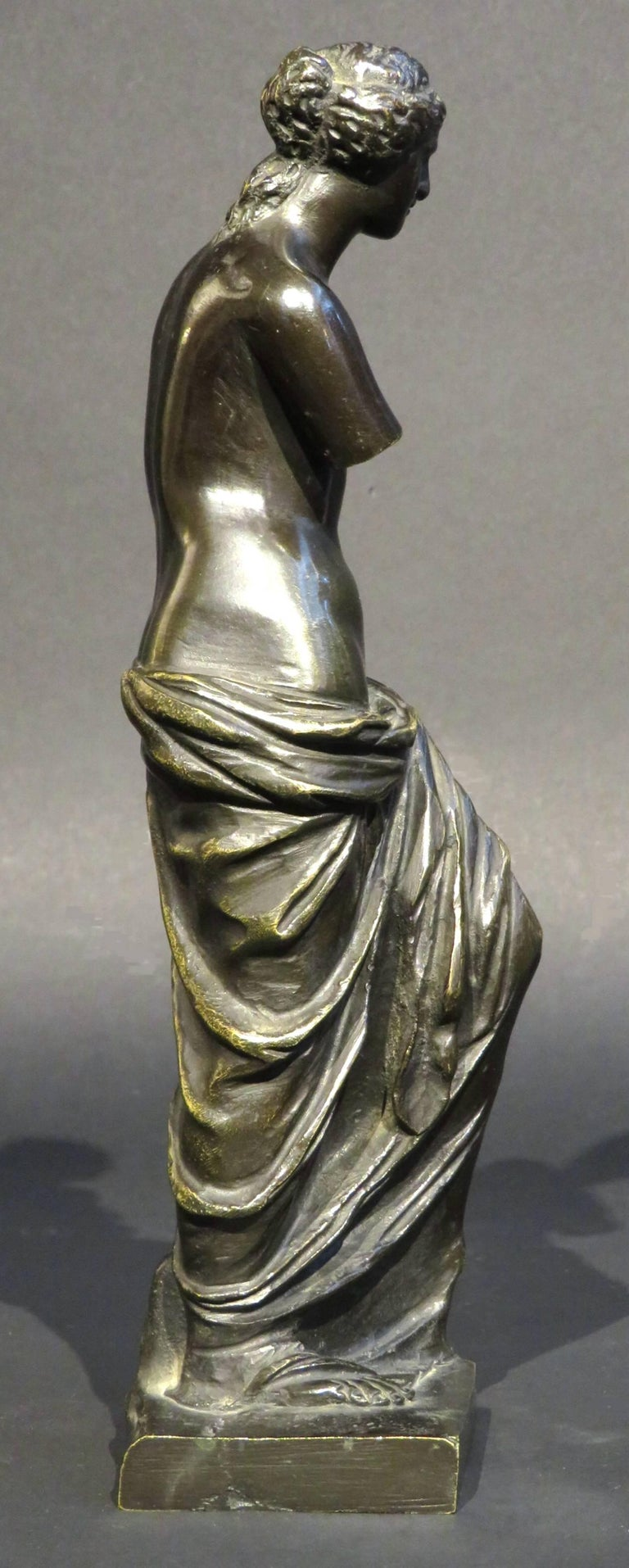 Finely cast and exhibiting a fine dark brown patina overall.