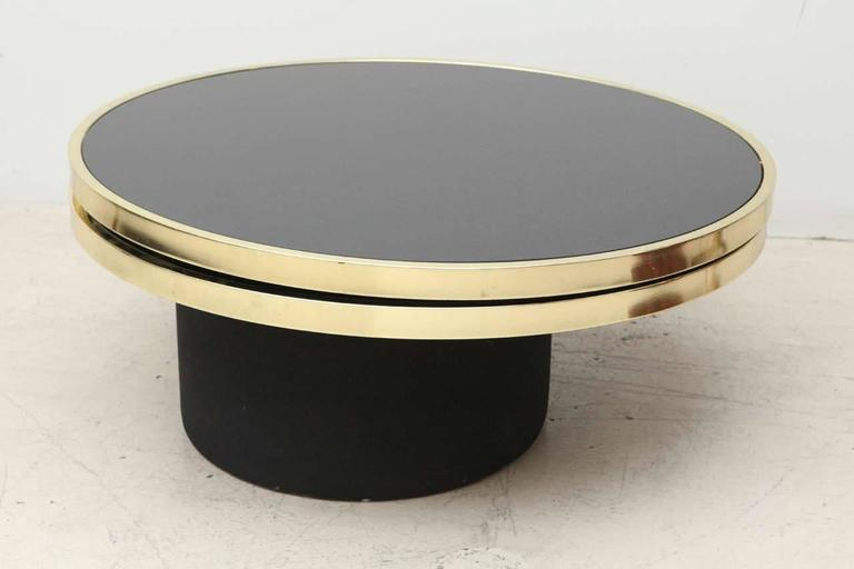 Black Glass And Brass Swivel Coffee Table By The Design Institute Of America At 1stdibs
